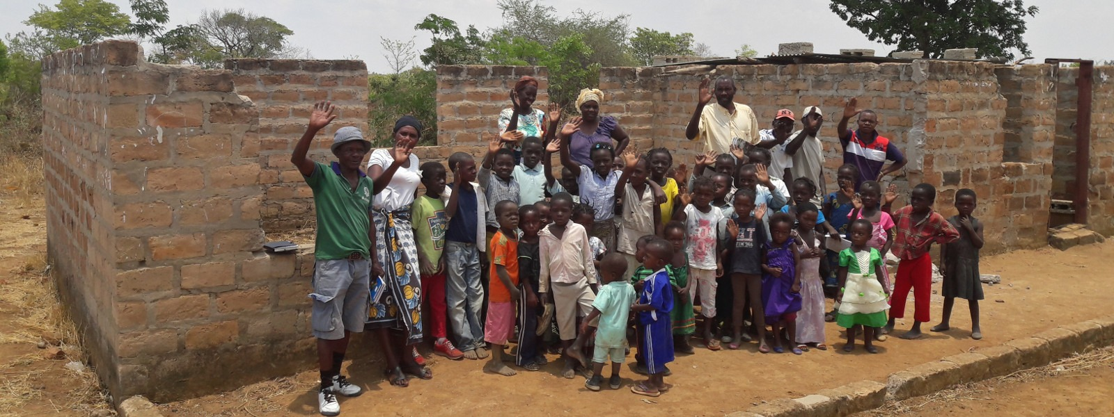 katole-16-11-03-pupils-infront-of-existing-school-1600