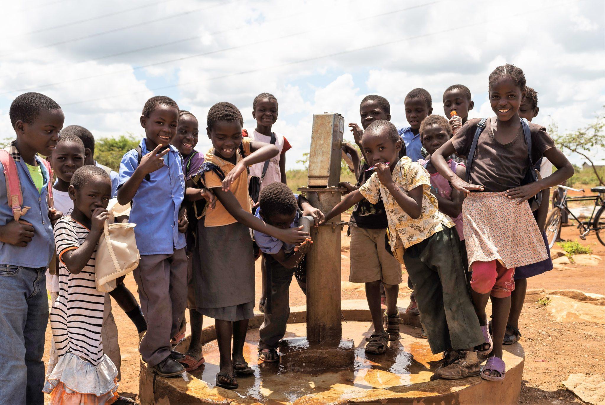 Children at water pump at Chitukuko