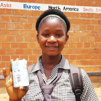 Bissell Community School pupil Patricia holding her bar of soap distributed as part of Safe Hands initiative