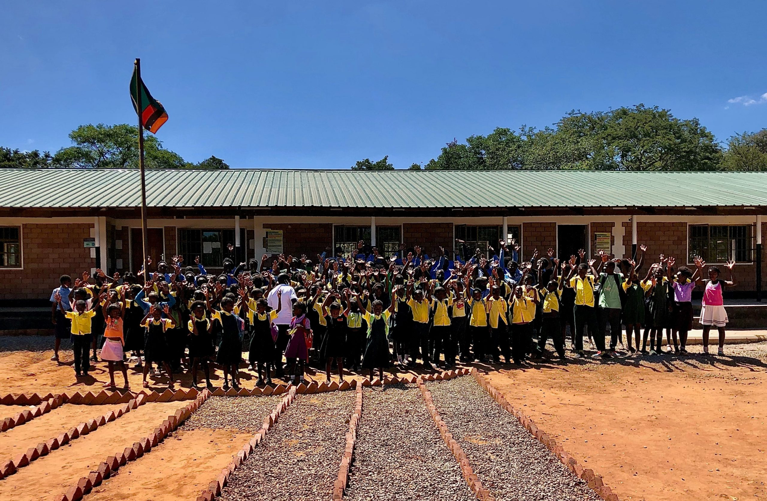 Group photo of children outside Naluyanda Community School