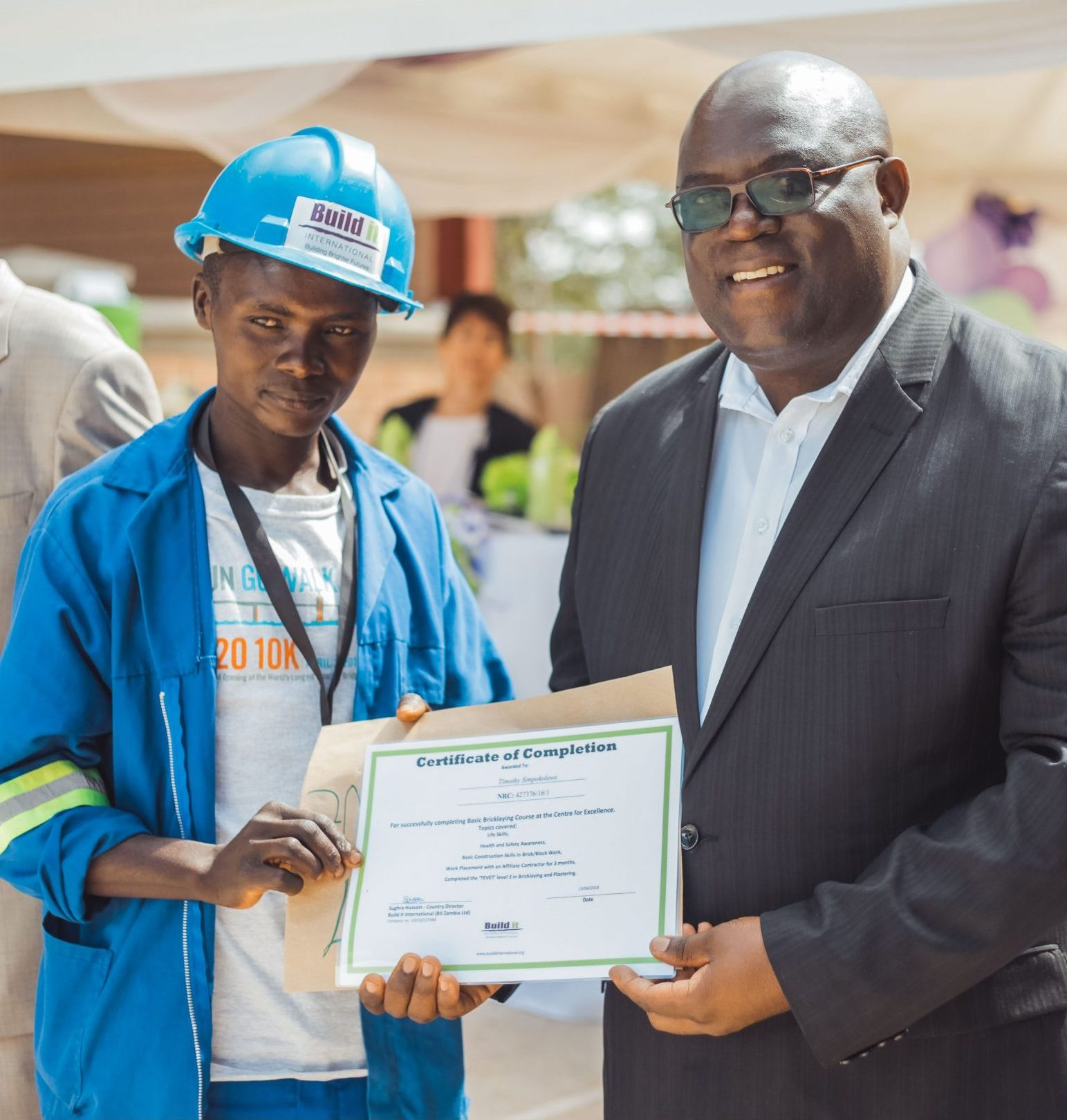 Timothy Simpokolowe receiving his training certificate at his graduation