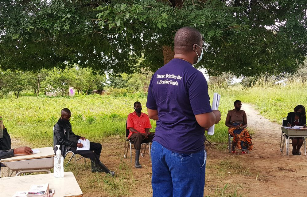 Mr Michael Mwamba , Disease Surveillance from Officer Public Health Officer from Zambia National Public Health Institute giving Covid-19 awareness talk at Mpamba Primary School
