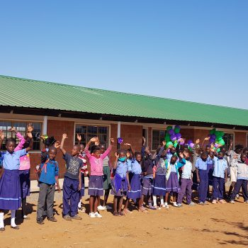 Children outside their new classrooms at Light of Hope Community School